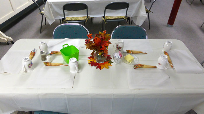 Decorations and place settings at our Fall Roast Pork Supper